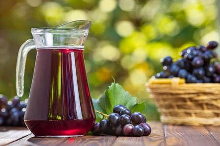 grape juice in glass jug Zdjęcie Seryjne - 129959921