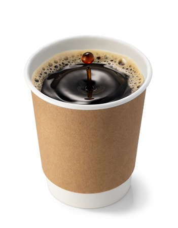 drop falling on coffee in paper cup and created splash with circle ripple