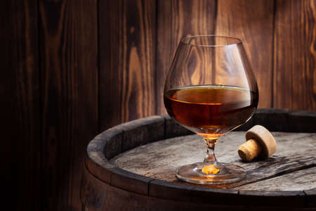 brandy or cognac in glass Фото со стока