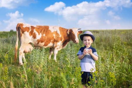 little boy drinking yogurt outdoors