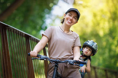 Mother with son riding on bike