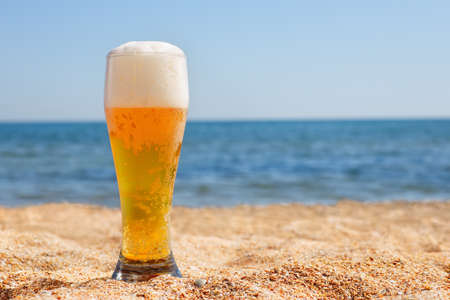 glass of beer with froth and bubbles