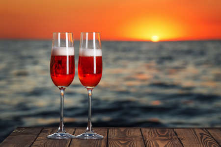two glasses of red champagne