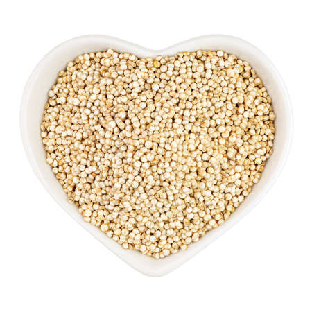 quinoa in heart shaped plate Archivio Fotografico