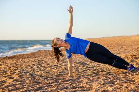 fitness woman standing in side plank