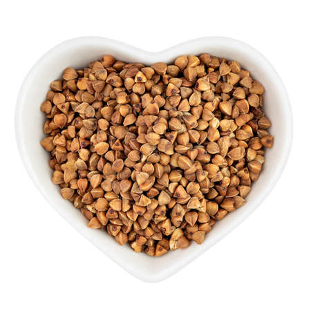 buckwheat groats in heart shaped plate