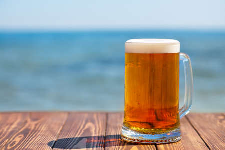 mug of beer with froth and bubbles