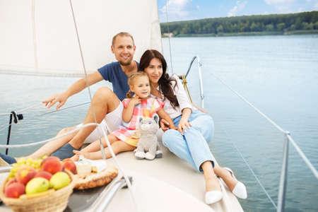 happy family sailing on boat