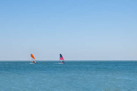 two windsurfing sails