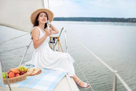 woman with glass of champagne Zdjęcie Seryjne - 156123202