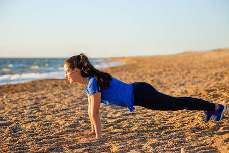 fitness woman standing in plank