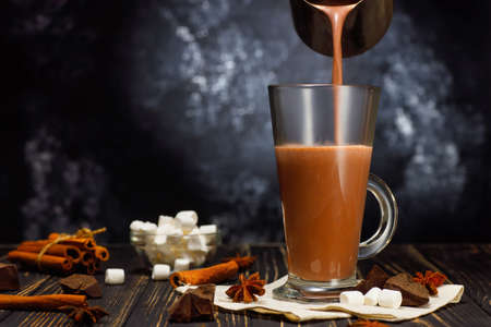 hot cocoa pouring in glass