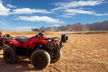 single red quad bike in egyptian desert Reklamní fotografie