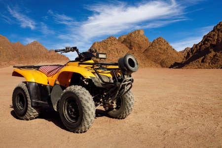 single yellow quad bike in egyptian desert