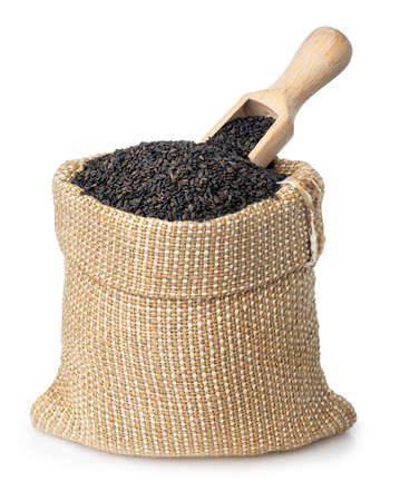 black sesame seeds in burlap sack isolated