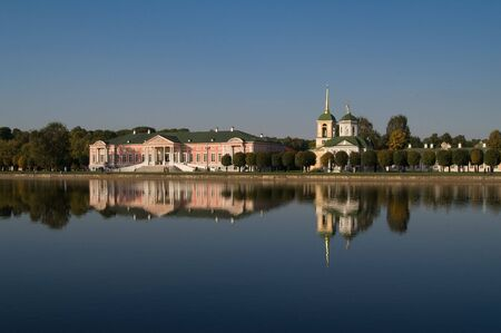 kuskovo: Old buildings near the lake with beautiful reflections Stock Photo