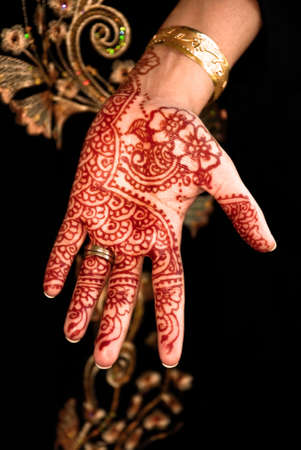 Beautiful Henna, Mehendi on the brides hand  photo