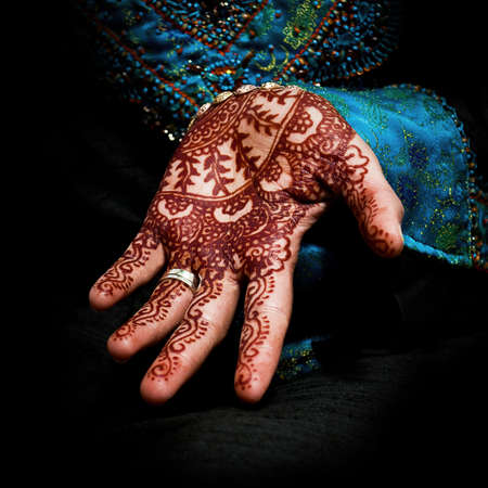 indian blue: Henna, mehendi on a bride s hand - fun square