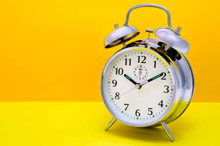 Alarm Clock - Orange and yellow background  photo