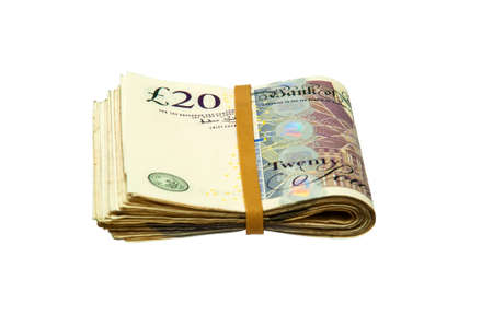 Folded Cash - 20 pound notes with clipping path on white background photo