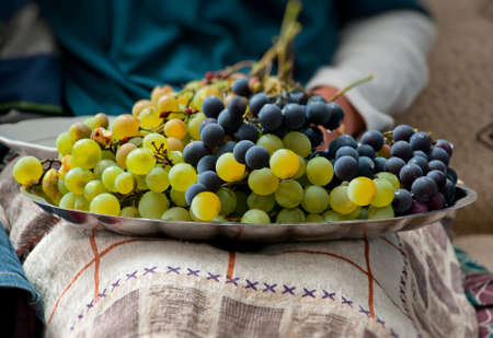 Plate of Grapes on the lap photo