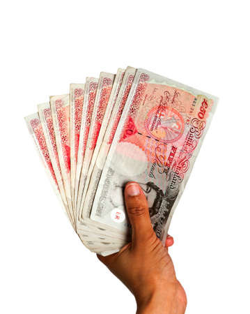 Money held in hand - UK Currency with clipping path - white BG photo