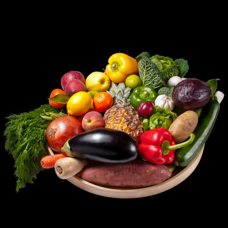Fruit and vegetables tray - black background photo