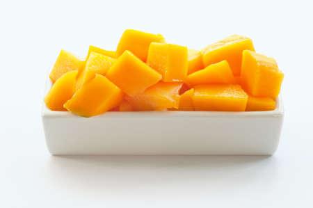 mango isolated: Mango Cubes on a white dish