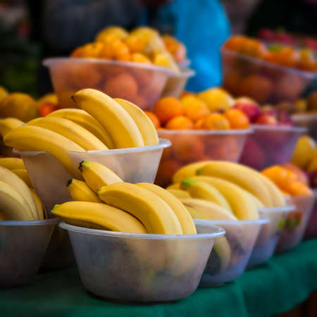 Outdoor farmer s market selling fruit in bowls photo