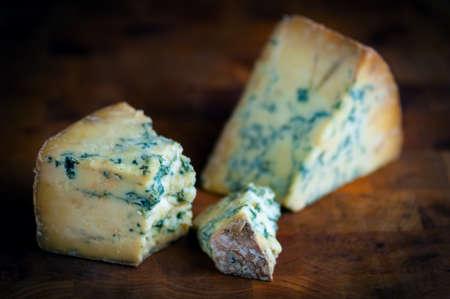 stilton: Stilton mature blue mouldy cheese - Dark background