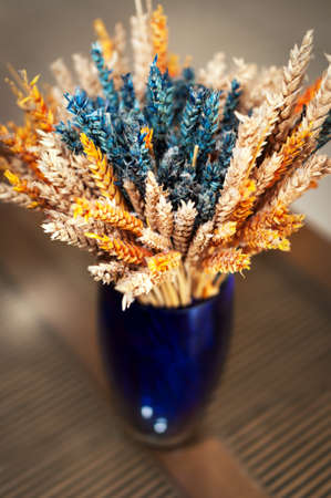 Colorful decorative vase with dried wheat Stock Photo - 27353047
