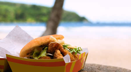 shark bay: Fried shark and bake fast food outdoors by the beach at Maracas Bay in Trinidad and Tobago authentic traditional local Caribbean meal Stock Photo