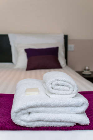 hygeine: Close-up clean towels and soap in hotel room