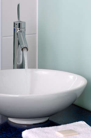 bowl sink: Bathroom sink bowl counter tap mixer towel soap Stock Photo