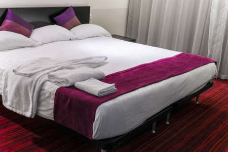 hotel suite: Contemporary hotel room suite queen size bed