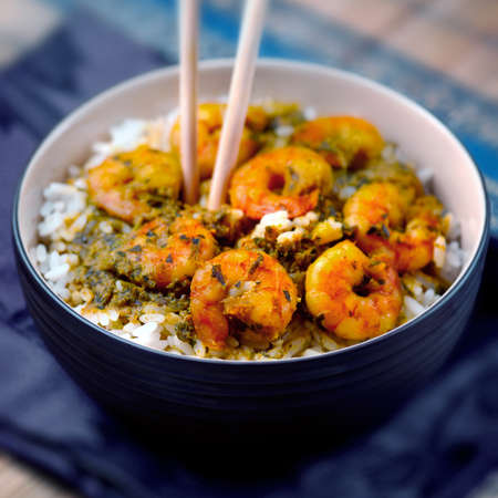 shrimp: Curry prawns shrimp and rice in a bowl Caribbean food Stock Photo
