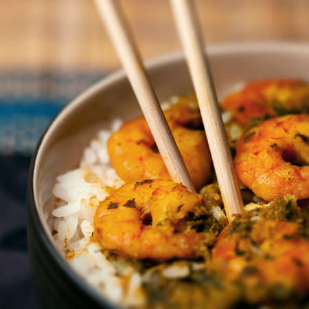 chinese bowl: Curry prawns shrimp and rice in a bowl Caribbean food Stock Photo