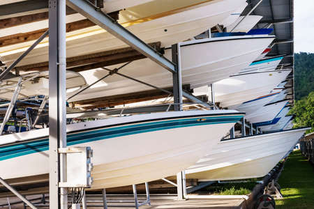 bow of boat: Power boats sheltered parking facility marina in Trinidad Stock Photo