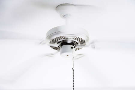 fan ceiling: White ceiling electrical fan in motion Stock Photo