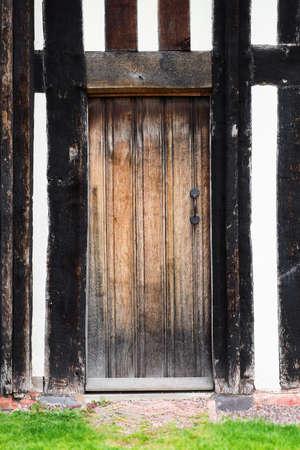 built in: Tudor house exterior detail built in 1590 detail of door Blakesley hall closeup