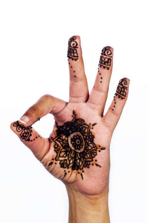 ok sign: Unique henna tattoo on white background ok sign medallion design