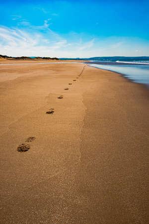 nostalgic: Aberdovey Aberdyfi Wales Snowdonia UK vast beautiful seascape holiday destination footprints on the sand nostalgic concept