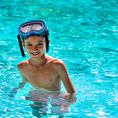 eight years old: Boy kid child eight years old inside swimming pool portrait happy fun bright day diving goggles square