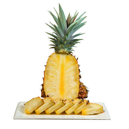 Pineapple clipping cutout on white plate cut in wedges white background Banco de Imagens