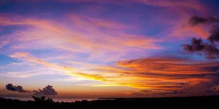 Sunset scene colorful clouds and sky dusk time in Tobago sea on the far away horizon Banco de Imagens