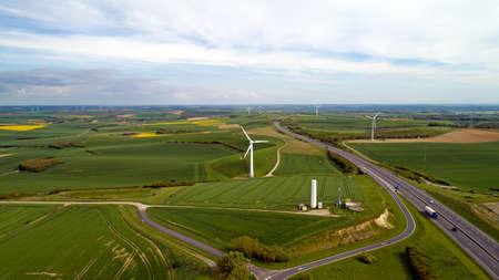 Aerial photo of wind turbines along the Estuary highway in Widehem Standard-Bild - 101227155