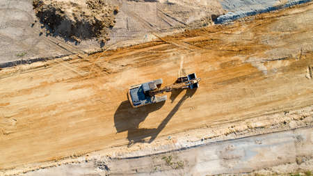 Aerial photo of a backhoe on a construction site