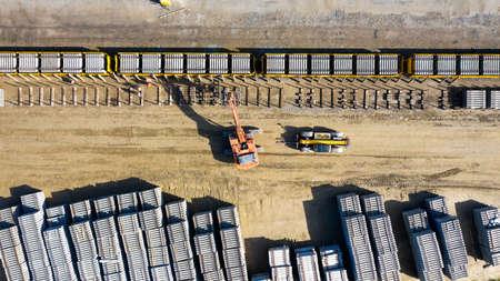 Heavy machines loading concrete railway sleepers on a train Stok Fotoğraf