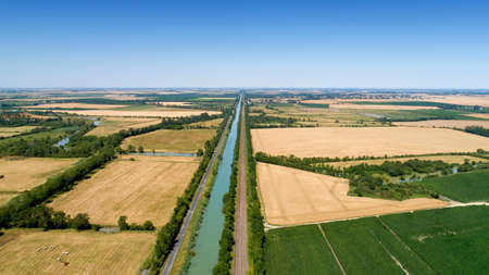 Aerial view of a canal and a railroad in the Poitevin marsh, France