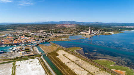 Aerial photo of a cement factory along the Berre lake in Port La Nouvelle